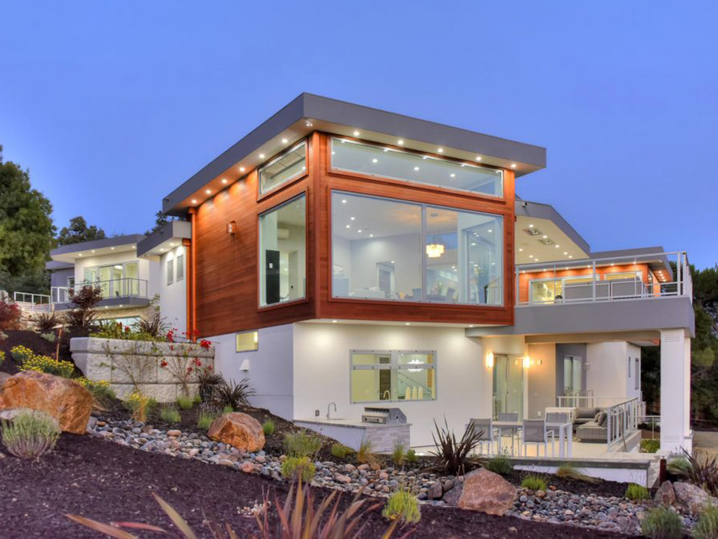 Custom stainless steel window and door systems showcase this contemporary villa