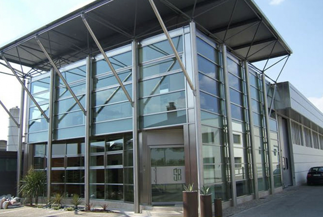 A stainless steel curtain wall is showcased at the front of the Brombal facility.
