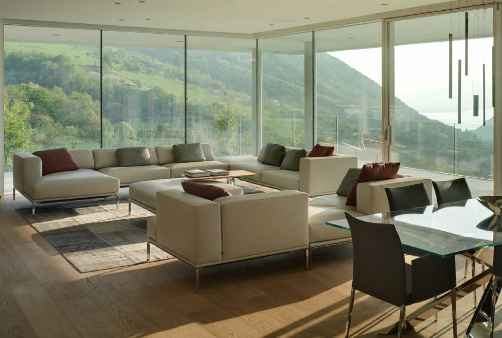 Oversized glass panels in this contemporary residence allow for breathtaking views of the surrounding landscape.