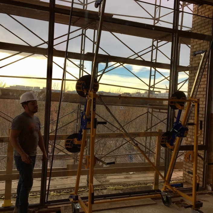 Installation of oversized glass on the third floor is made easier with the help of a WPG vacuum lift.