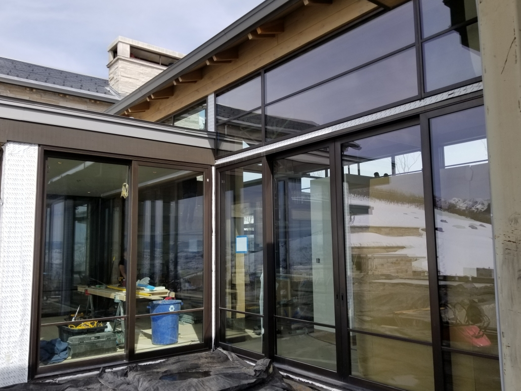 A steel lift slide door with oversized glass extends the interior living space..