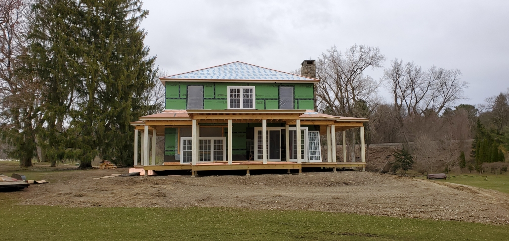 The installation of the all wood doors and double hung windows begins in this upstate New York estate.