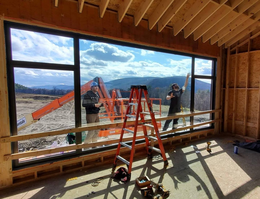 Our installation techs are making final adjustments to the custom oversized window in the Berkshires.