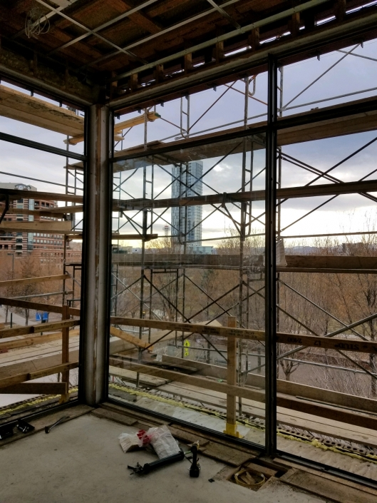 Our install techs continue to install the expansive glass in the oversized steel windows by Brombal.