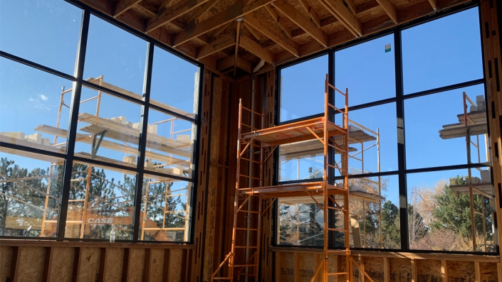 These fixed aluminum windows with a black finish and narrow sightlines replicate the look of steel.