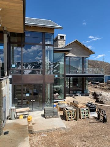 The rear elevation of this Park City mountain retreat has expansive window walls.