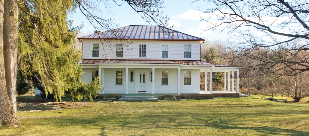 This classic farmhouse in upstate New York features all wood double hung windows and doors from Pinus.