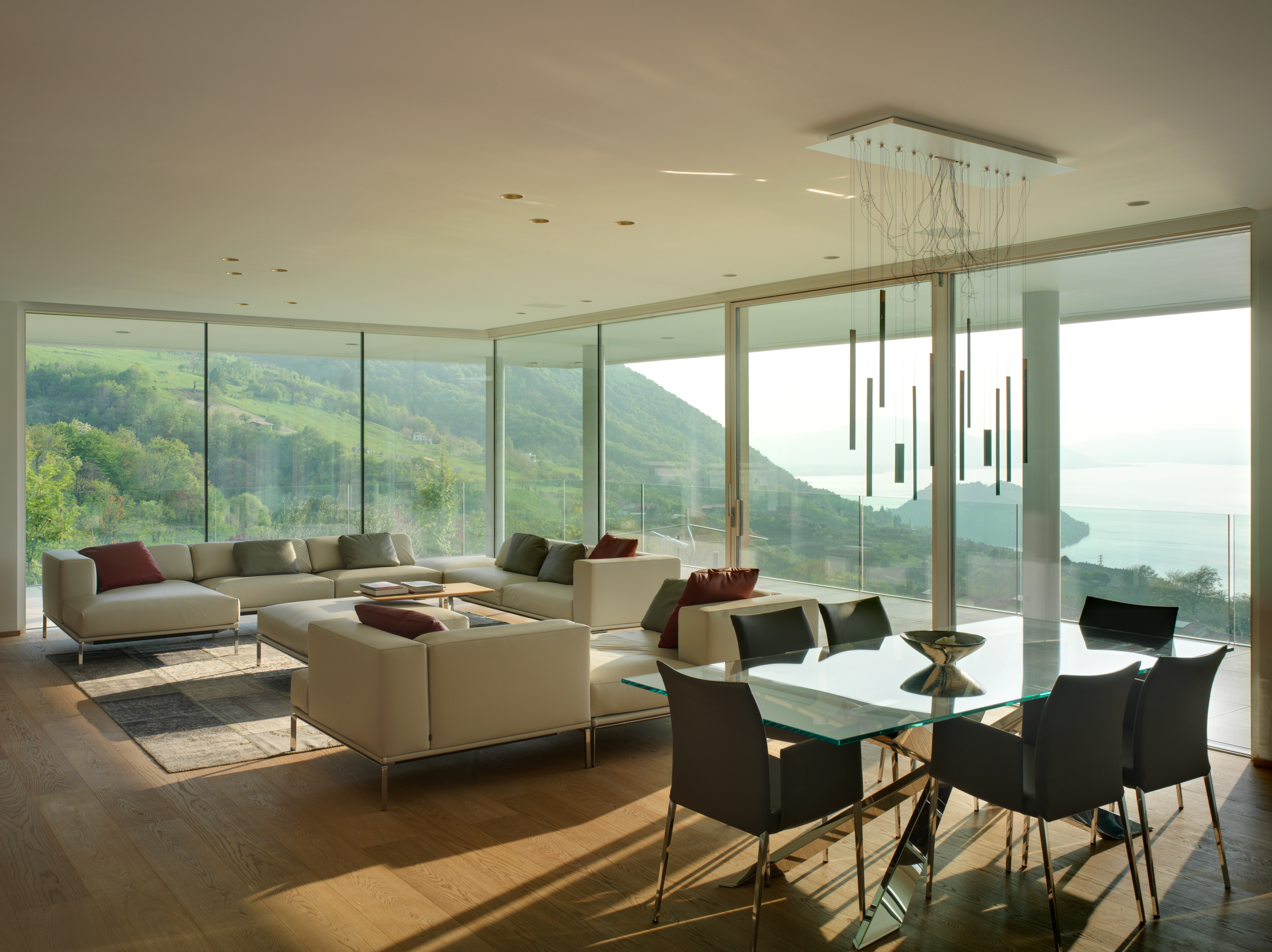 Floor to ceiling minimal frame glass windows and and oversized lift slide door provide unobstructed views