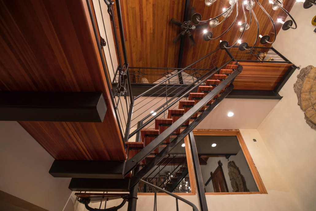 multi level iron and wood staircase