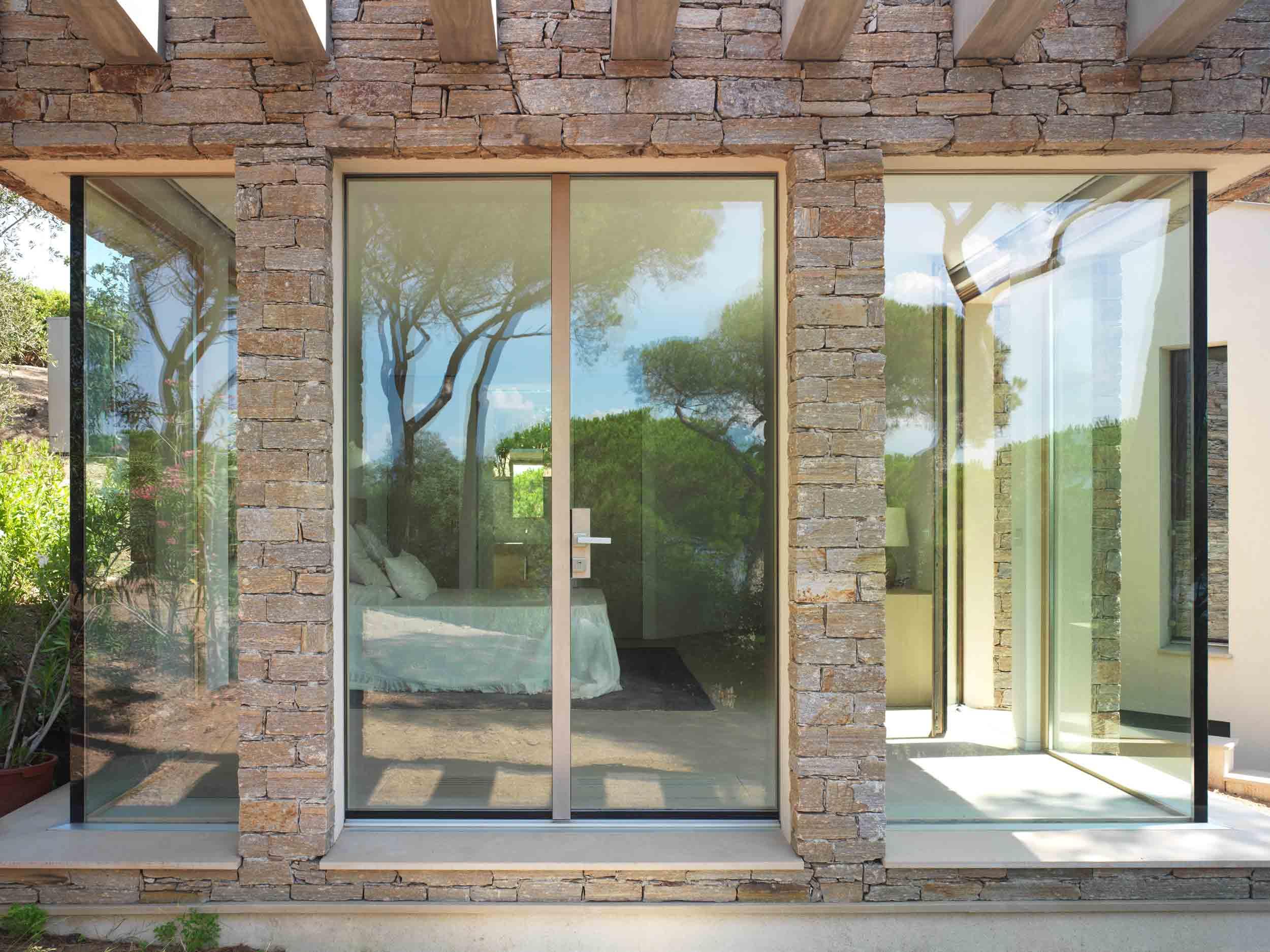 A custom minimal frame entrance door by Carminati from Veranda View