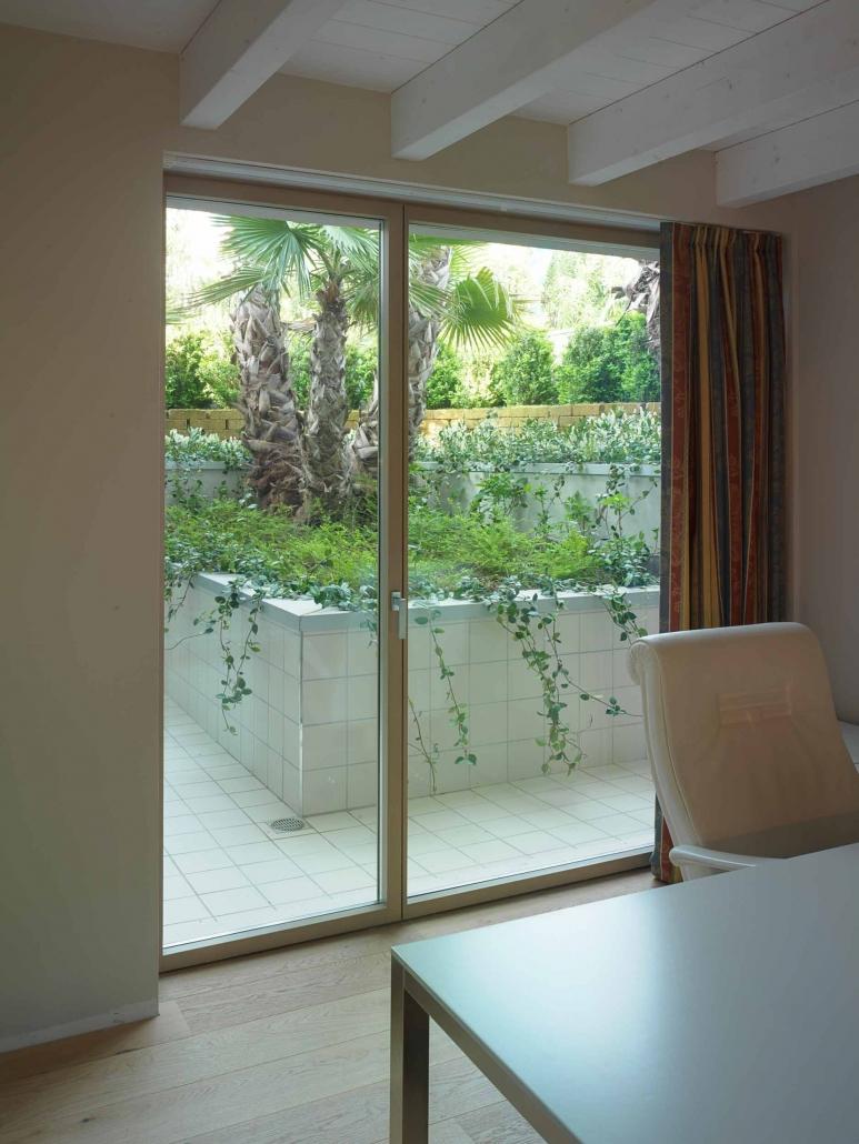 Minimal frame wood patio door system