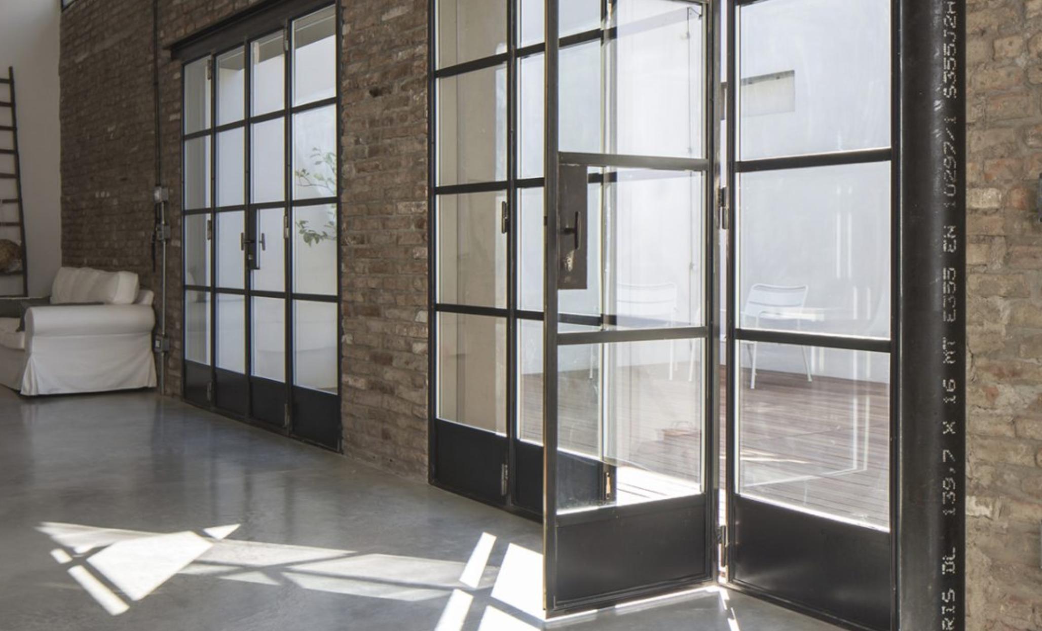 Minimal frame Inswing metal door system