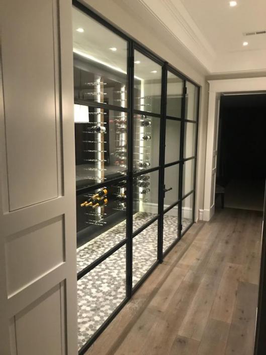 Custom metal wine cellar door system finished in black