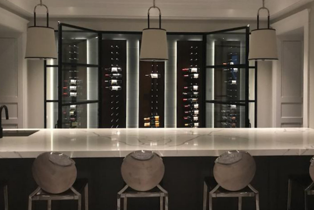 A minimal frame custom metal door system for a magnificent wine cellar