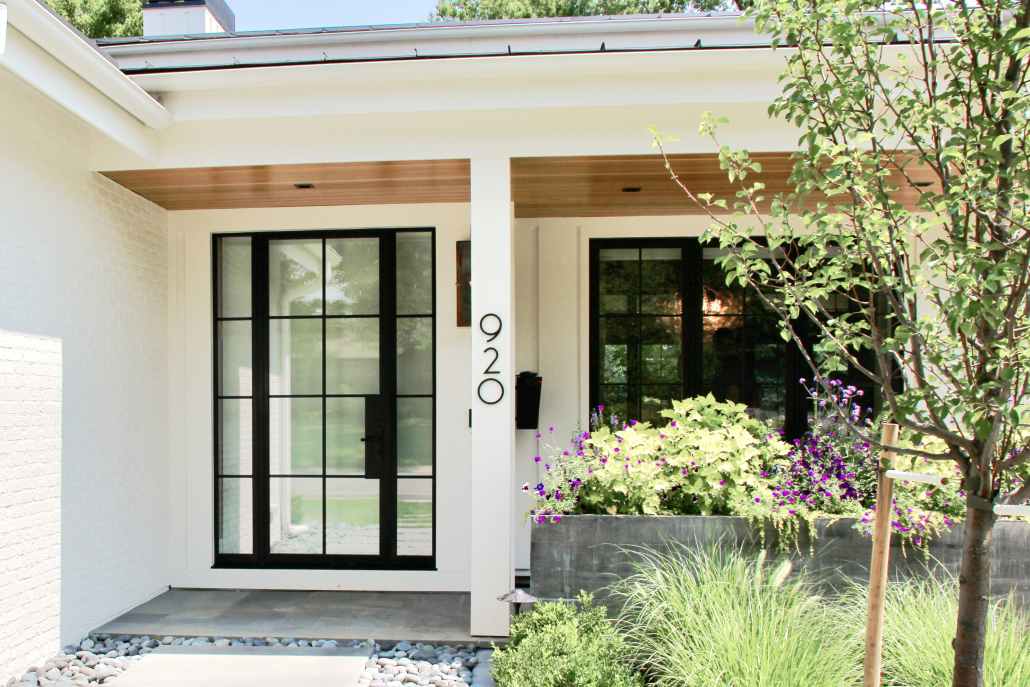 This thermally broken custom steel door by Vintage Steel completes the home's contemporary design.